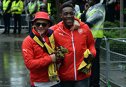 © Licensed to London News Pictures. 31/05/2015. <br /> LONDON, UK. The Arsenal FC first team and manager Arsene Wenger parade the FA Cup trophy through the streets of North London in an open top bus to celebrate winning the FA Cup yesterday. Jack Wilshere and Danny Welbeck partake in the victory parade.  London, Sunday 31 May 2015. Photo credit : Hannah McKay/LNP