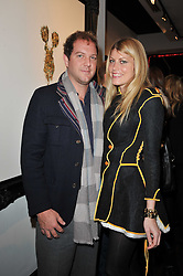 MEREDITH OSTROM and TOPPER MORTIMER at a collective exhibition of work entitles Bling Bling held at Opera Gallery, 134 New Bond Street, London on 15th December 2010.  Proceeds from the evening were raised for The Prince's Foundation for Children & the Arts.