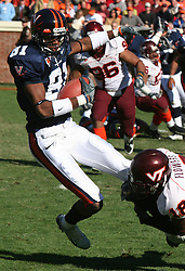 Virginia wide receiver Deyon Williams (81) is tackled by Virginia Tech cornerback Brandon Flowers (18).  The Virginia Tech Hokies defeated The Virginia Cavaliers 52-14 on November 19, 2005 at Scott Stadium in Charlottesville, VA.