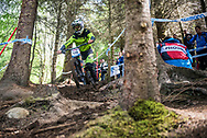 Matthew Walker finding his way in through the woods during his qualifying round at the UCI Mountain Bike World Cup in Fort William, Scotland.