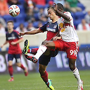 Bradley Wright-Phillips, (right), New York Red Bulls, is challenged by Patrick Nyarku, Chicago Fire, during the New York Red Bulls Vs Chicago Fire, Major League Soccer regular season match at Red Bull Arena, Harrison, New Jersey. USA. 10th May 2014. Photo Tim Clayton