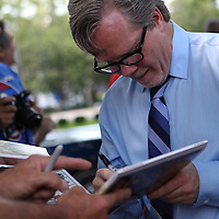 Inductee and trainer Freddie Roach signs autographs during the 23rd Annual International Boxing Hall of Fame Induction ceremony at the International Boxing Hall of Fame on Sunday, June 10, 2012 in Canastota, NY. (AP Photo/Alex Menendez)