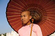 Nun with umbrella, Kutho Taur Pagaoda of 729 marble slabs, Mandalay, Burma