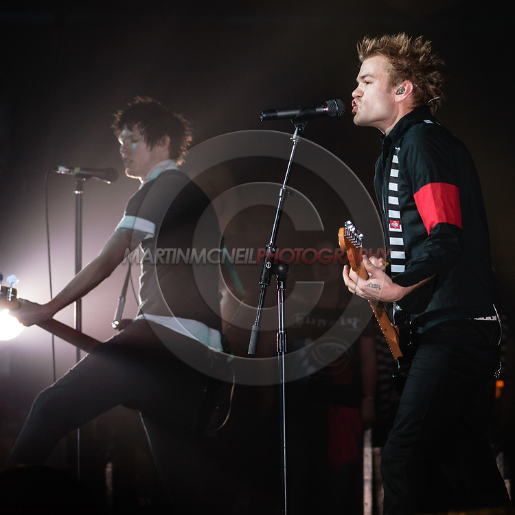 GLASGOW, SCOTLAND, MARCH 1, 2008: Jason McCaslin (L) and Deryck Whibley of rock band SUM 41 perform on stage inside the Barrowland Ballroom in Glasgow, Scotland (Copyright: Martin McNeil)