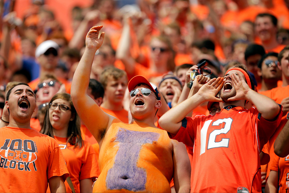 Illinois fans cheer from the Block I student section during the second half of an NCAA college football game at Memorial Stadium Saturday, Aug. 30, 2014, on the University of Illinois campus in Champaign, Ill. Illinois won the game 28-17. (Lee News Service/ Stephen Haas)