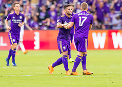April 8, 2018 - Orlando, FL, U.S. - ORLANDO, FL - APRIL 08: Orlando City forward Dom Dwyer (14) celebrates with Orlando City forward Chris Mueller (17) giving orlando its first goal during the MLS soccer match between the Orlando City FC and the Portland Timbers at Orlando City SC on April 8, 2018 at Orlando City Stadium in Orlando, FL. (Photo by Andrew Bershaw/Icon Sportswire) (Credit Image: © Andrew Bershaw/Icon SMI via ZUMA Press)