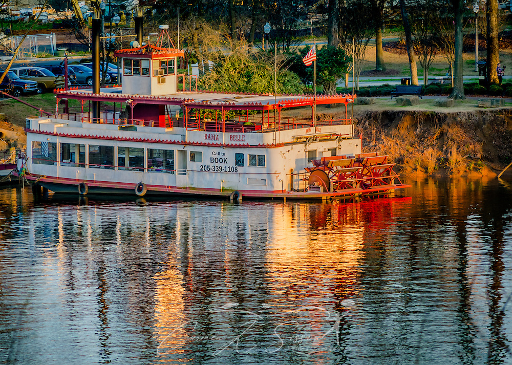 The sun sets on the Black Warrior River and the Bama Belle riverboat March 18, 2014 in Tuscaloosa, Alabama. (Photo by Carmen K. Sisson/Cloudybright)