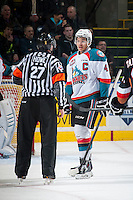 KELOWNA, CANADA - FEBRUARY 28: Madison Bowey #4 of Kelowna Rockets skates speaks to the referee on February 28, 2015 at Prospera Place in Kelowna, British Columbia, Canada.  (Photo by Marissa Baecker/Shoot the Breeze)  *** Local Caption *** Madison Bowey;