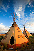 A pair of tipis in the warm glow of the setting sun. Near Taos, New Mexico.
