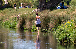 © Licensed to London News Pictures. 20/05/2020. London, UK. A women cools off in the Beverley Brook in Richmond Park in South West London as weather experts predict the warmest day of the Year with a high of 27c. Last week the Government eased the law on lockdown to let people spend more time outside to enjoy sunbathing and picnicking. Photo credit: Alex Lentati/LNP