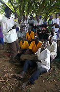 Locals and former abductees, sing together old traditional Luo (acholi) songs as a sign of forgiveness in the little village of Oculokori, northern Uganda.  At least 20,000 children, women and men were abducted into LRA Joseph Kony's army over the years and forced to take part in horrific killings.  (PHOTO: MIGUEL JUAREZ LUGO).