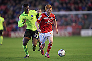 Walsall midfielder, Reece Flanagan goes past Brighton central midfielder, Rohan Ince during the Capital One Cup match between Walsall and Brighton and Hove Albion at the Banks's Stadium, Walsall, England on 25 August 2015.