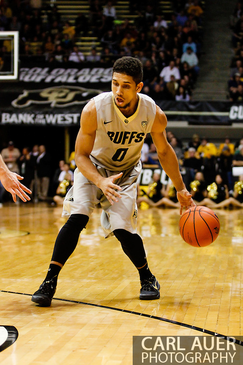 November 13th, 2013:  Colorado Buffaloes junior guard Askia Booker (0) dribbles the ball in the first half of the NCAA Basketball game between the University of Wyoming Cowboys and the University of Colorado Buffaloes at the Coors Events Center in Boulder, Colorado