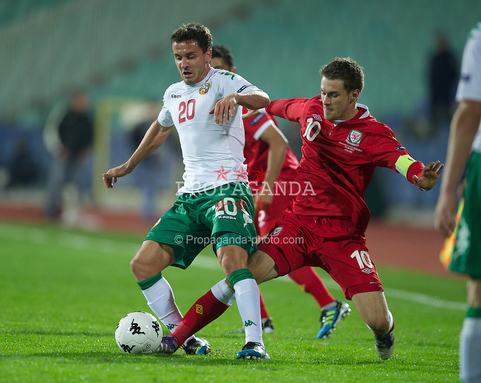 SOFIA, BULGARIA - Tuesday, October 11, 2011: Wales' captain Aaron Ramsey in action against Bulgaria's Dimitar Rangelov during the UEFA Euro 2012 Qualifying Group G match at the Vasil Levski National Stadium. (Pic by David Rawcliffe/Propaganda)