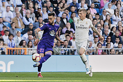 March 16, 2019 - Madrid, Madrid, Spain - Real Madrid's Toni Kroos and Real Club Celta de Vigo's Brais Mendez seen in action during La Liga match between Real Madrid and Real Club Celta de Vigo at Santiago Bernabeu Stadium in Madrid, Spain. (Credit Image: © Legan P. Mace/SOPA Images via ZUMA Wire)