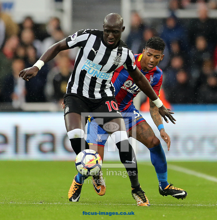Mohamed Diame (l) of Newcastle United and Patrick van Aanholt of Crystal Palace during the Premier League match at St. James's Park, Newcastle<br /> Picture by Simon Moore/Focus Images Ltd 07807 671782<br /> 21/10/2017