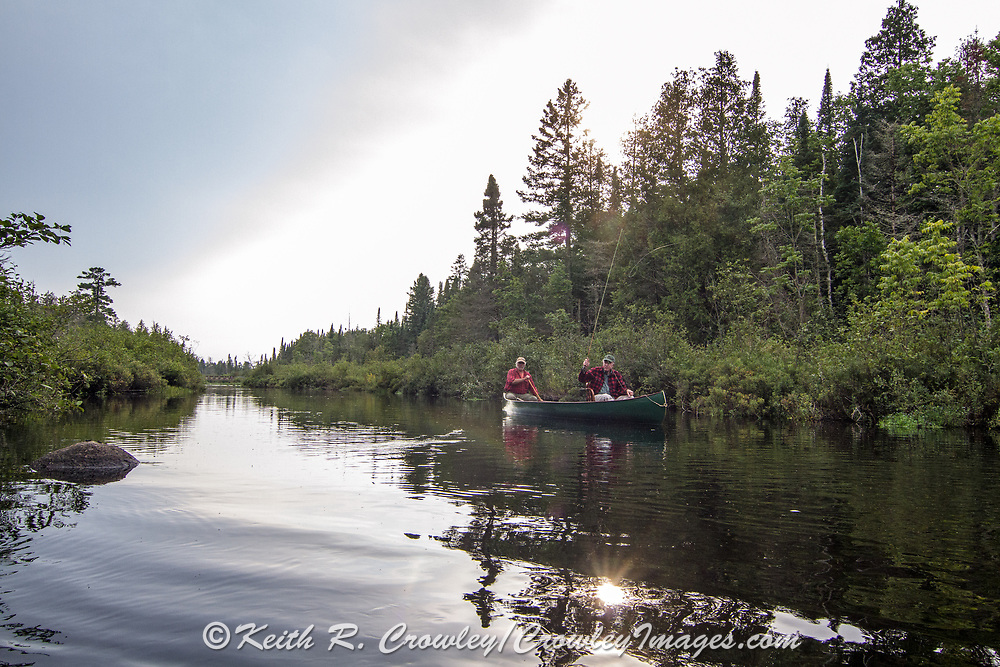 Brule River fishing guide Damian Wilmot (left) paddles the Upper Brule near Lake Nebagamon, Wisconsin, with angler Matson Holbrook in a 1895 Joe Lucius Brule Guide Canoe Wilmot meticulously restored over the course of two years.