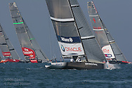 BMW Oracle Racing team chases opponents in first leg of America's Cup fleet race; Valencia, Spain.