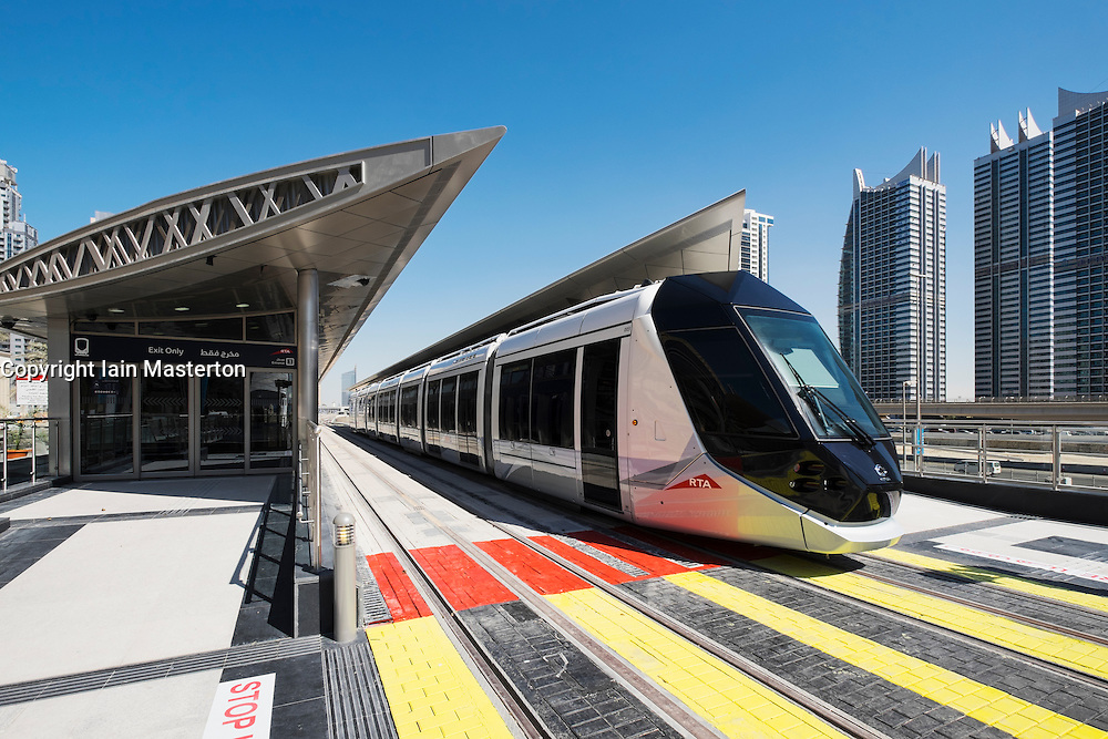 Station and tram on new Dubai Tram system in Marina district of Dubai United Arab Emirates