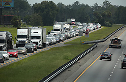 Traffic rolls at a crawl on the northbound lanes of Florida's Turnpike near the intersection of I-75 in Wildwood on Friday, Sept. 8, 2017. Motorists are evacuating for the anticipated arrival of Hurricane Irma.  (Stephen M. Dowell/Orlando Sentinel/TNS/Sipa USA)