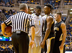 Players from both teams exchange words during the first half at the WVU Coliseum.