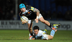 Exeter Chiefs Jack Nowell is tackled by Newcastle Falcons Juan Pablo Socino  - Photo mandatory by-line: Harry Trump/JMP - Mobile: 07966 386802 - 14/02/15 - SPORT - Rugby - Aviva Premiership - Sandy Park, Exeter, England - Exeter Chiefs v Newcastle Falcons