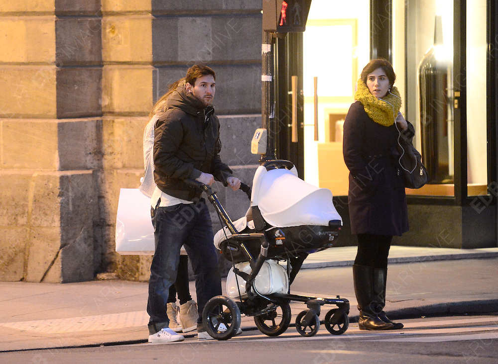 11.FEBRUARY.2013. PARIS<br /> <br /> ARGENTINA AND BARCELONA SOCCER PLAYER LIONEL MESSI AND HIS GIRLFRIEND ANTONELLA ROCUZZO ARE SPOTTED STROLLING WITH THEIR BABY SON THIAGO IN PARIS, FRANCE ON FEBRUARY 11<br /> <br /> BYLINE: EDBIMAGEARCHIVE.CO.UK<br /> <br /> *THIS IMAGE IS STRICTLY FOR UK NEWSPAPERS AND MAGAZINES ONLY*<br /> *FOR WORLD WIDE SALES AND WEB USE PLEASE CONTACT EDBIMAGEARCHIVE - 0208 954 5968*