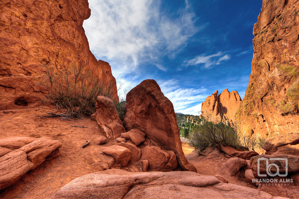 A landscape photo of the red rocks in the Garden of the Gods park in Colorado Springs, Colorado.
