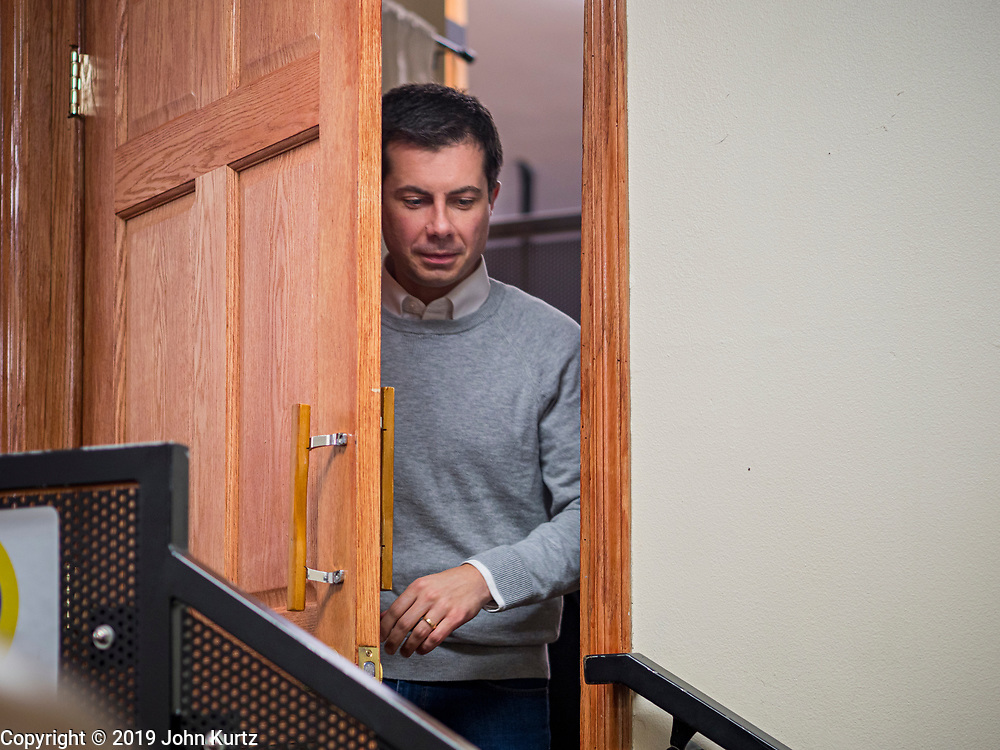 28 DECEMBER 2019 - DES MOINES, IOWA: Mayor PETE BUTTIGIEG, walks into a meet and greet with Buttigieg in Des Moines. Buttigieg talked to a crowd of about 75 people at Urban Dreams, an African-American community empowerment center in Des Moines. It was a part of Buttigieg's continuing outreach to African-American voters. Buttigieg, the mayor of South Bend, Indiana, is running to be the Democratic nominee for President in the 2020 election. Iowa traditionally holds the first presidential selection event of the 2020 election cycle. The Iowa Caucuses are on Feb. 3, 2020.           PHOTO BY JACK KURTZ