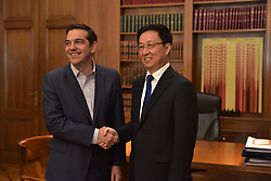 June 12, 2017 - Athens, Attiki, Greece - Handshake between Greek Prime Minister Alexis Tsipras (left) and of Han Zheng, (right) member of the political office of the Central Committee and Secretary of the Shanghai's Committee Party of the Communist Party of China. (Credit Image: © Dimitrios Karvountzis/Pacific Press via ZUMA Wire)
