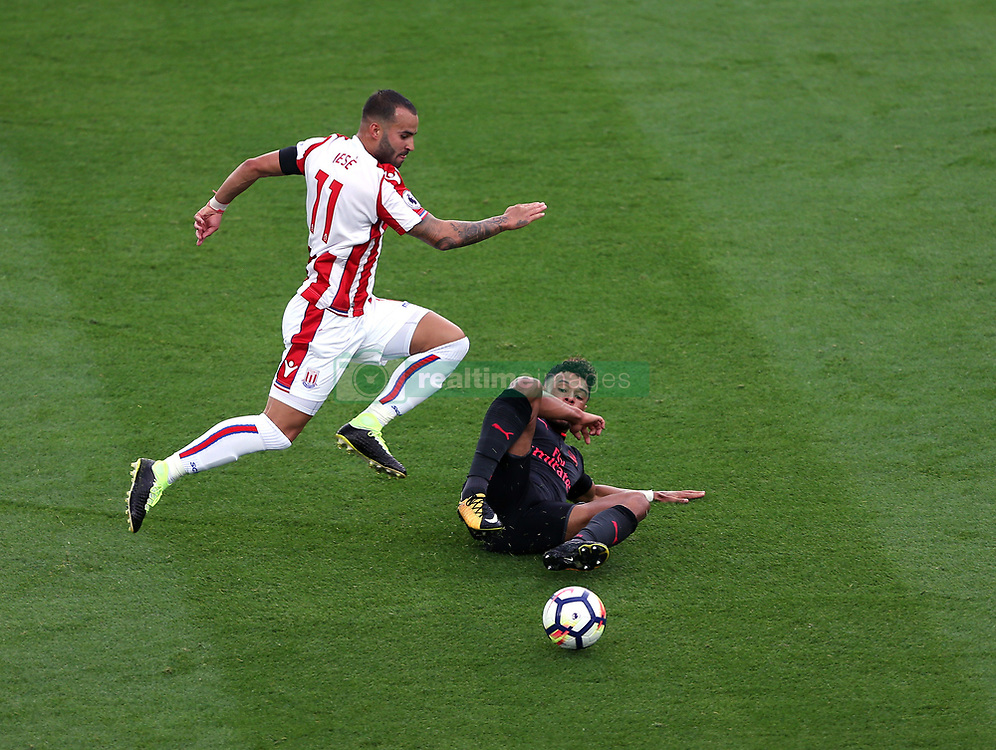 19 August 2017  : Premier League Football : Stoke City v Arsenal:  Jese Rodriguez of Stoke skips over a tackle by Alex Oxlade-Chamberlain: Photo: Mark Leech