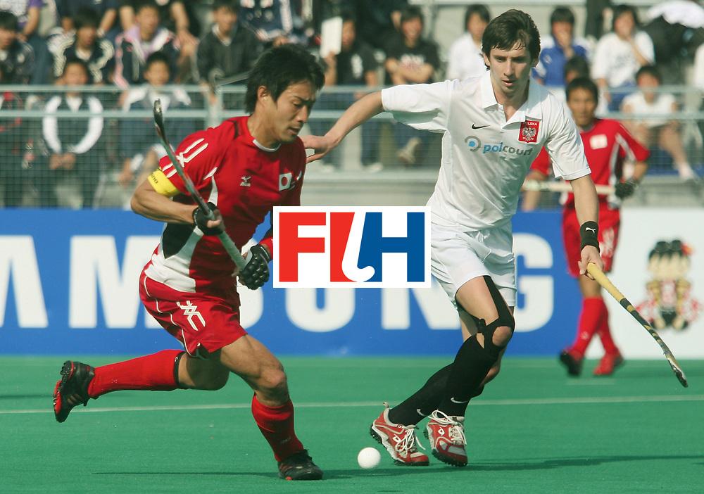 Kakamigahara, Gifu-Japan : Yamabori Takahiro of Japan gets past Kluczynski Miroslaw of Poland in the Olympic Hockey Qualifier at Gifu Perfectural Green Stadium at Kakamigahara on 06 April 2008. Japan beat Poland 6-1  <br /> Photo: GNN/ Vino John