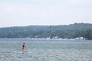 A stand-up paddle boarder on Canandaigua Lake on Sunday, July 27, 2014.