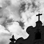 Cross on the top of old fountain at Alentejo