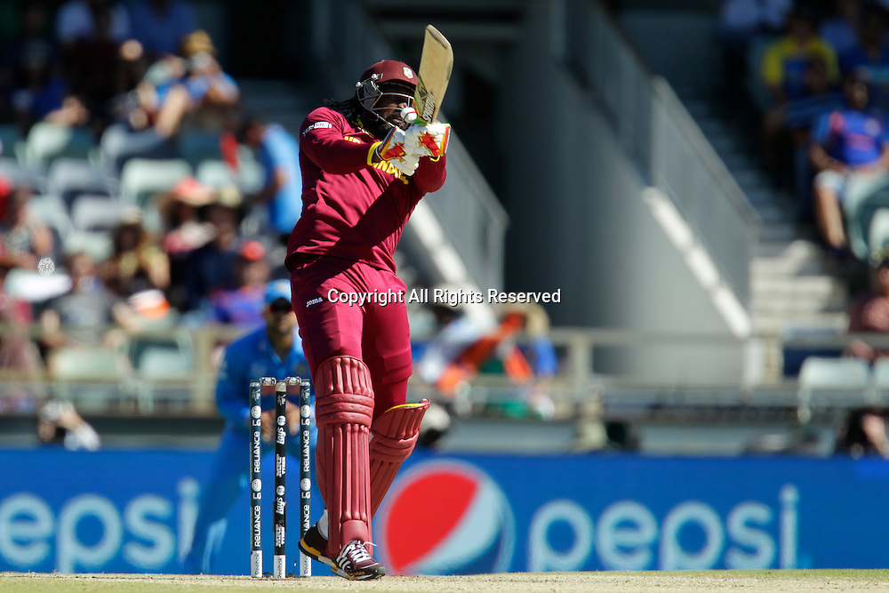 06.03.2015. Perth, Australia. ICC Cricket World Cup. India versus West Indies. Chris Gayle hits a big six during his innings of 21.