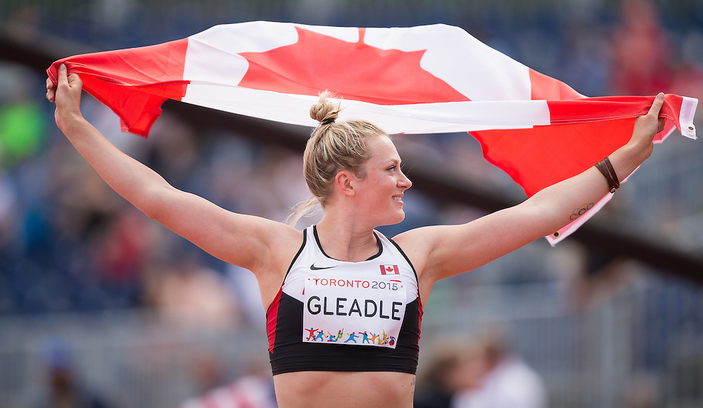 Elizabeth Beadle of Canada celebrates her gold medal win in the javelin on the first day of athletics competition at the 2015 Pan American Games in Toronto, Canada, July 21,  2015.   AFP PHOTO/GEOFF ROBINS