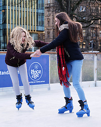 Edinburgh's Christmas 2016, Friday 18th November 2016<br /> <br /> The Edinburgh's Christmas Ice Rink in St Andrew's Square opened to the public today.<br /> <br /> !3-year-olds Katie Millwood (wearing a tartan scarf) and Melissa Heron were first on the ice.<br /> <br /> (c) Alex Todd | Edinburgh Elite media