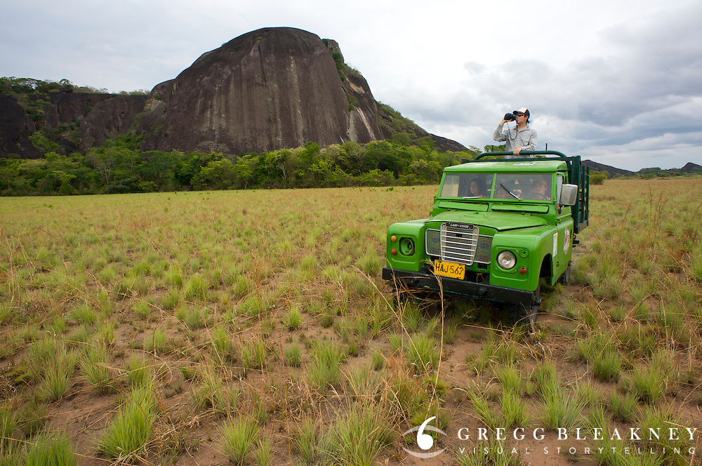 An ecology student/rock climber scopes routes on a Tepuy mesa, one of the oldest rock formations in the world - La Reserva Natural Bojonawi - Orinoco River Basin - Colombia - South America