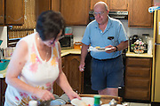 Ralph and Rosemarie Paladino, both 68, prepare dinner at their home in Utica, NY on September 3, 2015. The Paladinos live primarily on Ralph's police officer's pension and social security, and have home equity loan with an interest rate linked to the prime lending rate. A Fed rate increase would force their already tight budget even further. Photographer: Mike Bradley/Bloomberg