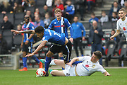 Nathaniel Mendez-Laing is fouled during the EFL Sky Bet League 1 match between Milton Keynes Dons and Rochdale at stadium:mk, Milton Keynes, England on 11 March 2017. Photo by Daniel Youngs.