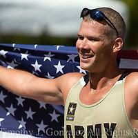 John Nunn celebrates after winning the mens Olympic Trials 20K race walk in 1:25:36, in Salem, Ore., on Thursday  June 30, 2016.
