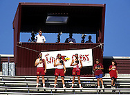 """PHOENIX, AZ-UNDATED:  Phoenix Cardinals dressed up as """"Wild Cards"""" fans pause for the National Anthem prior to a game at Sun Devil Stadium in Phoenix, Arizona.  (Photo by Ron Vesely)"""