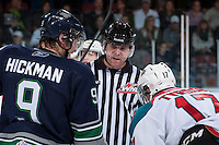 KELOWNA, CANADA - APRIL 5: Reagan Vetter, referee, lines up players at the face off between the Kelowna Rockets and the Seattle Thunderbirds on April 5, 2014 during Game 2 of the second round of WHL Playoffs at Prospera Place in Kelowna, British Columbia, Canada.   (Photo by Marissa Baecker/Getty Images)  *** Local Caption *** Reagan Vetter; referee;