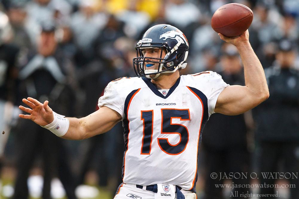 December 19, 2010; Oakland, CA, USA;  Denver Broncos quarterback Tim Tebow (15) throws a pass against the Oakland Raiders during the third quarter at Oakland-Alameda County Coliseum. Oakland defeated Denver 39-23.