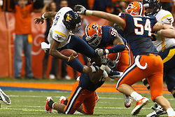 Oct 21, 2011; Syracuse NY, USA;  West Virginia Mountaineers quarterback Geno Smith (12) is sacked by Syracuse Orange linebacker Siriki Diabate (back, left) and defensive tackle Jay Bromley (back, right) during the third quarter at the Carrier Dome.  Syracuse defeated West Virginia 49-23. Mandatory Credit: Jason O. Watson-US PRESSWIRE