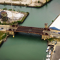 Chicago 95th Street Bridge aerial picture in high resolution. The 95th Street Bridge was used in the draw bridge jump scene in the movie The Blues Brothers. The 95th Street Bridge is a bascule bridge located in Chicago's South Side and spans the Calumet River. At the bottom left is the famous Calument Fisheries smokehouse restaurant. Aerial picture was taken in 2013.