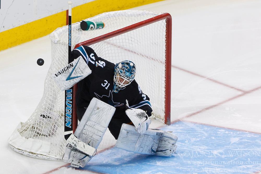 Feb 10, 2012; San Jose, CA, USA; San Jose Sharks goalie Antti Niemi (31) saves a shot against the Chicago Blackhawks during the third period at HP Pavilion. San Jose defeated Chicago 5-3. Mandatory Credit: Jason O. Watson-US PRESSWIRE