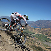 Richard Leacock from Wellington in action during the New Zealand South Island Downhill Cup Mountain Bike series held on The Remarkables face with a stunning backdrop of the Wakatipu Basin. 150 riders took part in the two day event. Queenstown, Otago, New Zealand. 9th January 2012. Photo Tim Clayton