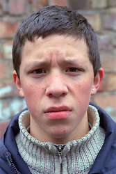 Portrait of teenage young offender,