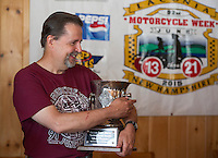 Mayor Ed Engler receives the Fritzie Baer Award during the Motorcycle Week kickoff event held at Faro Restaurant in Weirs Beach Thursday morning.  (Karen Bobotas/for the Laconia Daily Sun)